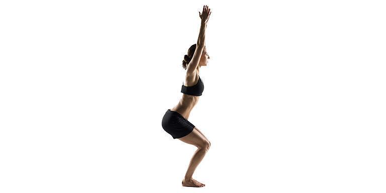 Woman yoga chair pose