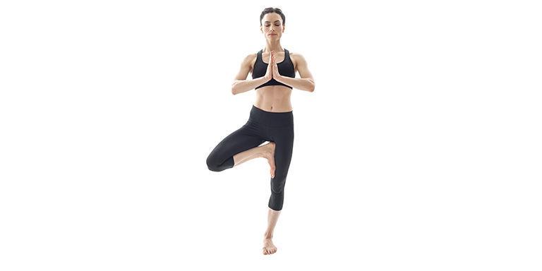 Woman yoga tree pose