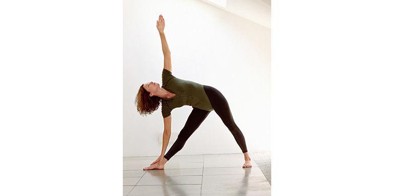 Woman yoga triangle pose
