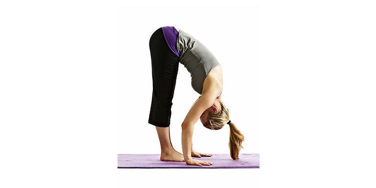 Woman yoga forward fold