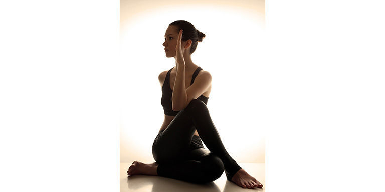 Woman yoga seated twist