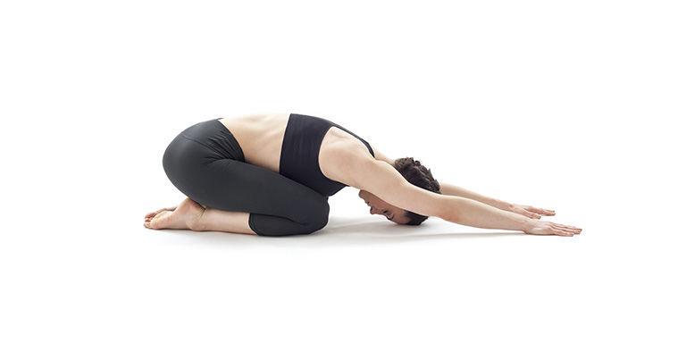 Woman yoga child pose