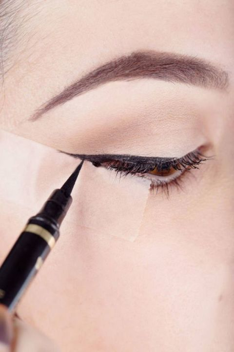 Use a small piece of scotch tape to flawlessly apply liquid eyeliner every time.<br />Get the tutorial at Harper's Bazaar.<br />